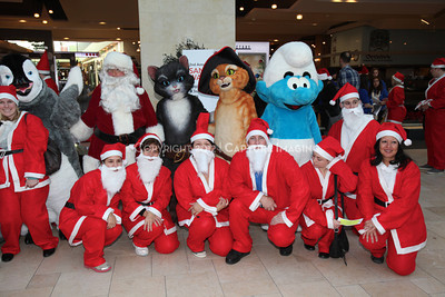 1112229-0026    CANOGA PARK, CA - DECEMBER 4: Over 500 people in Santa costumes walk during the 2nd Annual Santa Walk fundraiser benefiting Variety the Children's Charity of Southern California at Westfield Topanga on December 4, 2011 in Canoga Park, California. (Photo by Ryan Miller/Capture Imaging)