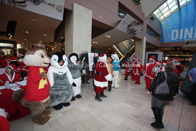 1112229-0013    CANOGA PARK, CA - DECEMBER 4: Over 500 people in Santa costumes walk during the 2nd Annual Santa Walk fundraiser benefiting Variety the Children's Charity of Southern California at Westfield Topanga on December 4, 2011 in Canoga Park, California. (Photo by Ryan Miller/Capture Imaging)