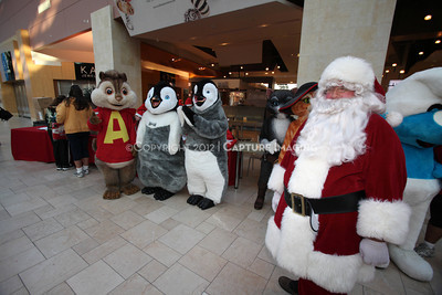 1112229-0041    CANOGA PARK, CA - DECEMBER 4: Over 500 people in Santa costumes walk during the 2nd Annual Santa Walk fundraiser benefiting Variety the Children's Charity of Southern California at Westfield Topanga on December 4, 2011 in Canoga Park, California. (Photo by Ryan Miller/Capture Imaging)
