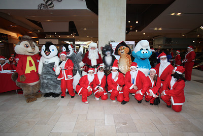 1112229-0030    CANOGA PARK, CA - DECEMBER 4: Over 500 people in Santa costumes walk during the 2nd Annual Santa Walk fundraiser benefiting Variety the Children's Charity of Southern California at Westfield Topanga on December 4, 2011 in Canoga Park, California. (Photo by Ryan Miller/Capture Imaging)