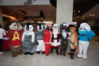 1112229-0006    CANOGA PARK, CA - DECEMBER 4: Over 500 people in Santa costumes walk during the 2nd Annual Santa Walk fundraiser benefiting Variety the Children's Charity of Southern California at Westfield Topanga on December 4, 2011 in Canoga Park, California. (Photo by Ryan Miller/Capture Imaging)