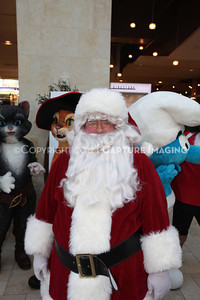 1112229-0038    CANOGA PARK, CA - DECEMBER 4: Over 500 people in Santa costumes walk during the 2nd Annual Santa Walk fundraiser benefiting Variety the Children's Charity of Southern California at Westfield Topanga on December 4, 2011 in Canoga Park, California. (Photo by Ryan Miller/Capture Imaging)