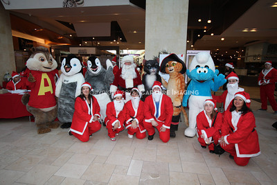 1112229-0031    CANOGA PARK, CA - DECEMBER 4: Over 500 people in Santa costumes walk during the 2nd Annual Santa Walk fundraiser benefiting Variety the Children's Charity of Southern California at Westfield Topanga on December 4, 2011 in Canoga Park, California. (Photo by Ryan Miller/Capture Imaging)