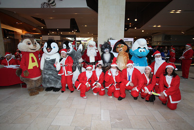 1112229-0027    CANOGA PARK, CA - DECEMBER 4: Over 500 people in Santa costumes walk during the 2nd Annual Santa Walk fundraiser benefiting Variety the Children's Charity of Southern California at Westfield Topanga on December 4, 2011 in Canoga Park, California. (Photo by Ryan Miller/Capture Imaging)