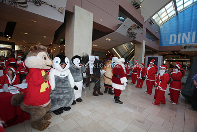1112229-0015    CANOGA PARK, CA - DECEMBER 4: Over 500 people in Santa costumes walk during the 2nd Annual Santa Walk fundraiser benefiting Variety the Children's Charity of Southern California at Westfield Topanga on December 4, 2011 in Canoga Park, California. (Photo by Ryan Miller/Capture Imaging)