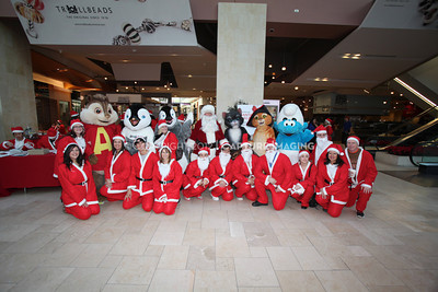 1112229-0020    CANOGA PARK, CA - DECEMBER 4: Over 500 people in Santa costumes walk during the 2nd Annual Santa Walk fundraiser benefiting Variety the Children's Charity of Southern California at Westfield Topanga on December 4, 2011 in Canoga Park, California. (Photo by Ryan Miller/Capture Imaging)