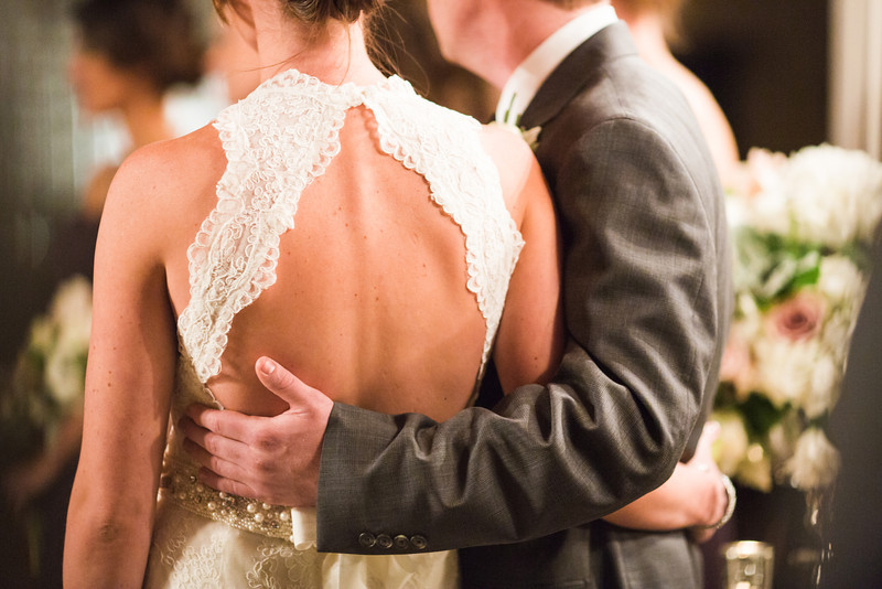 Winter wedding ceremony at Salvage One in Chicago. Wedding photographer – Ryan Davis Photography – Rockford, Illinois.