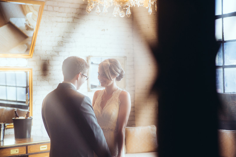 Preparations and pre-ceremony photography before a winter wedding at Salvage One in Chicago. Wedding photographer – Ryan Davis Photography – Rockford, Illinois.