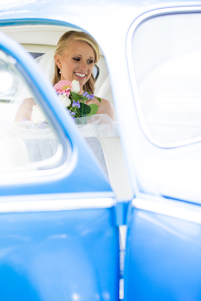Danelle sitting in a classic VW Bug