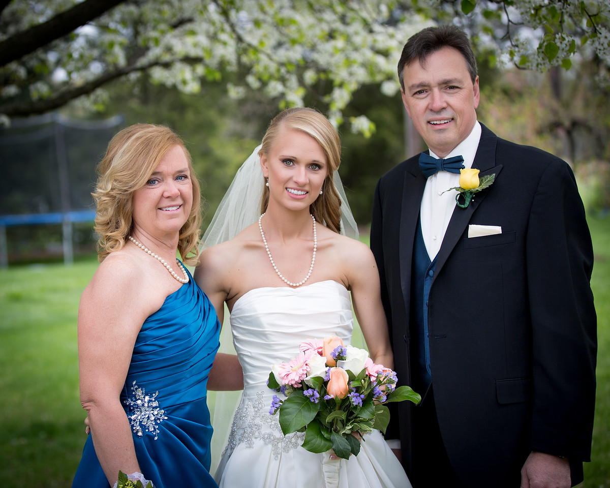 The bride with her mom & dad