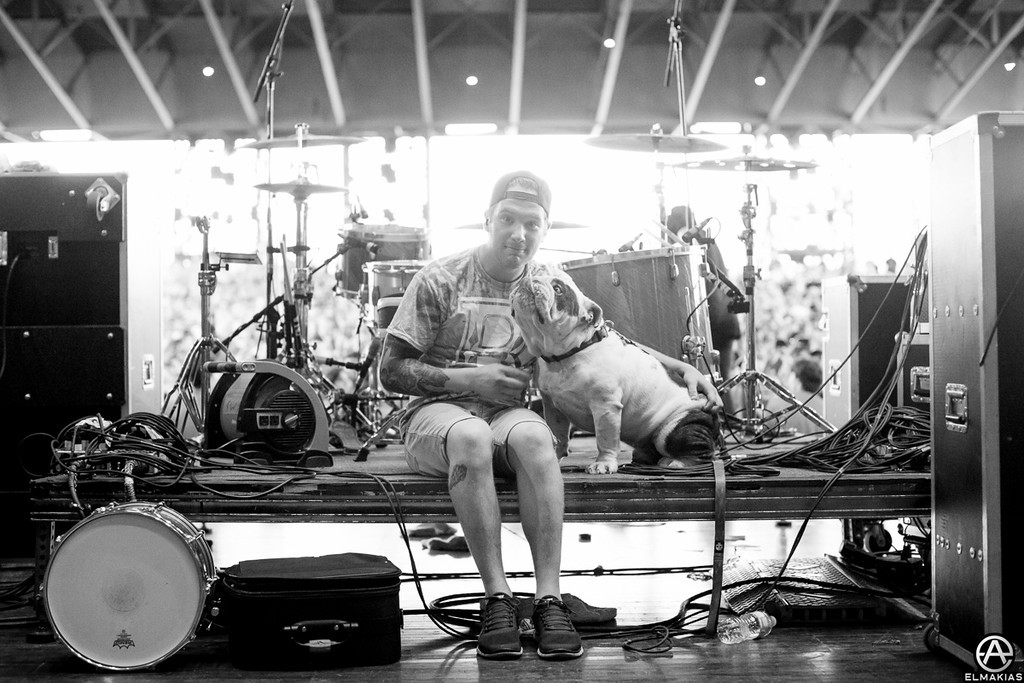 Gabe of Sleeping With Sirens and his pup right before hitting the stage
