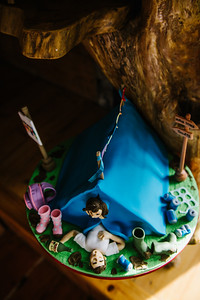 A quirky cake depicting a funny couple camping.  Newlyweds as it is a Wedding cake.