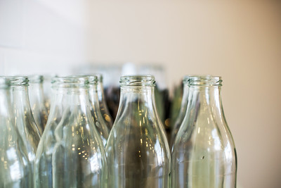 Empty milk glass juice bottles.