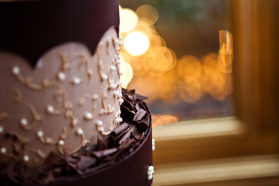 Amazing chocolate cake with candles in the background.