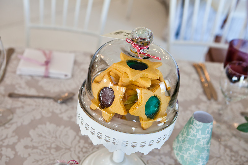 Star shaped jam cookies and buscuits in a glass sweet bowl.