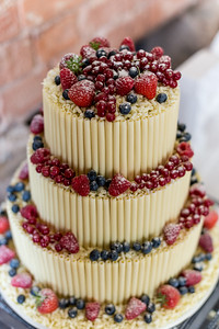 White chocalte flute cake with Strawberrys and other wild berries.