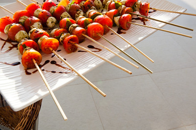 Gourmet vegetable skewers delicous on a plate with olive oil.