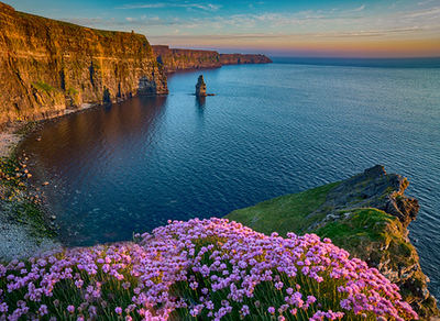 68540869 - ireland countryside tourist attraction in county clare. the cliffs of moher and castle ireland. epic irish landscape seascape along the wild atlantic way. beautiful scenic nature hdr ireland.
