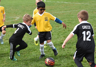 STAN HUDY - SHUDY@DIGITALFIRSTMEDIA.COM A Clifton Park Youth Soccer Club player looks to split two defenders during a U8 co-ed game Sunday, Oct. 8 at the Clifton Common during the 2016 Clifton Park Fall Soccer Classic.