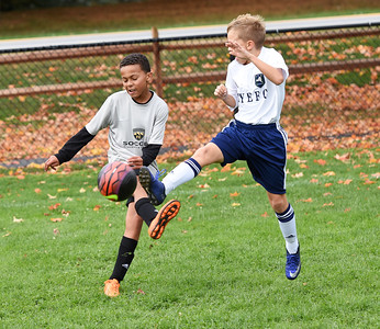 STAN HUDY - SHUDY@DIGITALFIRSTMEDIA.COM A Clifton Park Soccer Club player gets the ball off just as a New York Elite FC player looks to kick the ball during Sunday's competition at the Clifton Park Fall Soccer Classic on the Clifton Common, Oct. 9, 2016.