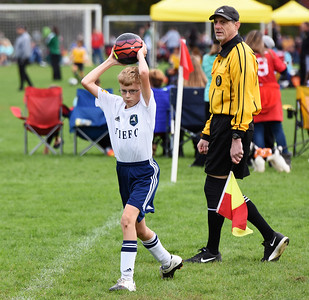 STAN HUDY - SHUDY@DIGITALFIRSTMEDIA.COM A New York Elite FC player throws the ball in during Sunday's competition at the Clifton Park Fall Soccer Classic on the Clifton Common, Oct. 9, 2016.