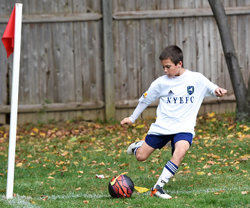 STAN HUDY - SHUDY@DIGITALFIRSTMEDIA.COM A New York Elite FC player executes a corner kick during Sunday's competition at the Clifton Park Fall Soccer Classic on the Clifton Common, Oct. 9, 2016.
