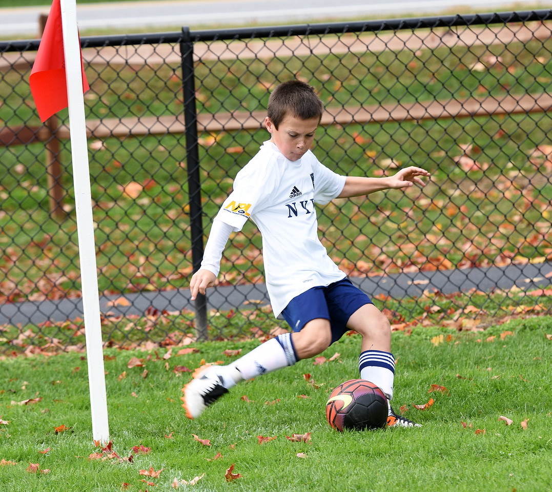 STAN HUDY - SHUDY@DIGITALFIRSTMEDIA.COMA New York Elite FC player executes a corner kick during Sunday's competition at the Clifton Park Fall Soccer Classic on the Clifton Common, Oct. 9, 2016.