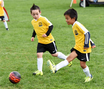 STAN HUDY - SHUDY@DIGITALFIRSTMEDIA.COM A Clifton Park Youth Soccer Club player kicks the ball upfield during a U8 co-ed game Sunday, Oct. 8 at the Clifton Common during the 2016 Clifton Park Fall Soccer Classic.