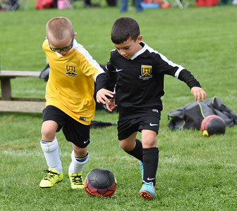 STAN HUDY - SHUDY@DIGITALFIRSTMEDIA.COM Two Clifton Park Youth Soccer Club players battle for a 50-50 ball during a U8 co-ed game Sunday, Oct. 8 at the Clifton Common during the 2016 Clifton Park Fall Soccer Classic.