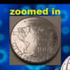 See the Chem trails behind the airplane at the top of the coin?