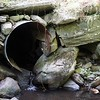 BEN GARVER — THE BERKSHIRE EAGLE<br /> This olde culvert on Benton Hill Road in Becket poses a problem for fish and flooding and will be replaced.  <br /> Executive Office of Energy and Environmental Affairs Secretary Kathleen Theoharides visited Becket to announce grants to support culvert replacement projects that improve municipal roads and river health in communities across the Commonwealth.<br /> Monday, September 14, 2020