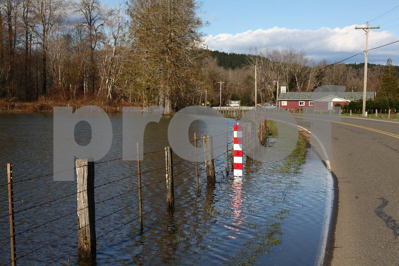 Flood markers along the road in the Skokomish River Valley, WA.