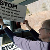 On the bus, Martha Cameron of BFP's Climate Action committee, shows riders the choice of signs we had produced. Martha, her husband Gary and our Treasurer, Eleanor Preiss, did a great job in organzing the BFP bus.