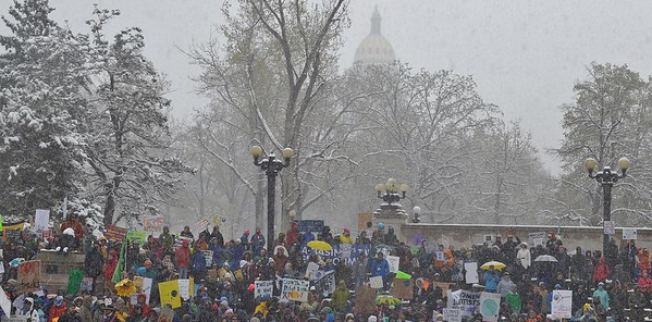 """The Colorado State Capitol dome provided a snowy backdrop to the """"People's Climate March"""" in Denver."""