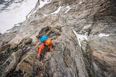Valentine climbing the last pitches of the Obergabelhorn South Face as it begins to rain!, Zermatt, Switzerland