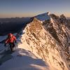 Tom Coney on the Weisshorn (4506m) North Ridge at sunrise, Switzerland