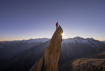 Michel Dvorak on the summit of the Salbitschijen summit after climbing the Westgrat, Switzerland