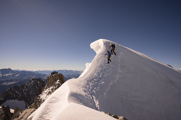 Anthony Richier and Adrien Estienne on the Aiguille d'Argentiere summit ridge, Chamonix, France/Switzerland