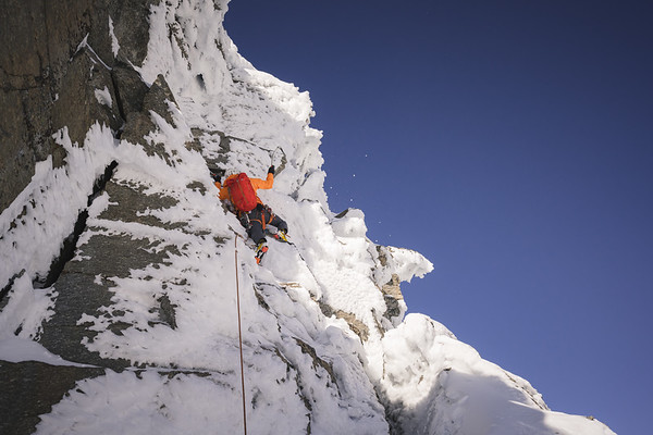 Tom Livingstone on the last pitch of Ciarforon SW ridge in winter conditions, Valle dell'Orco, Italy