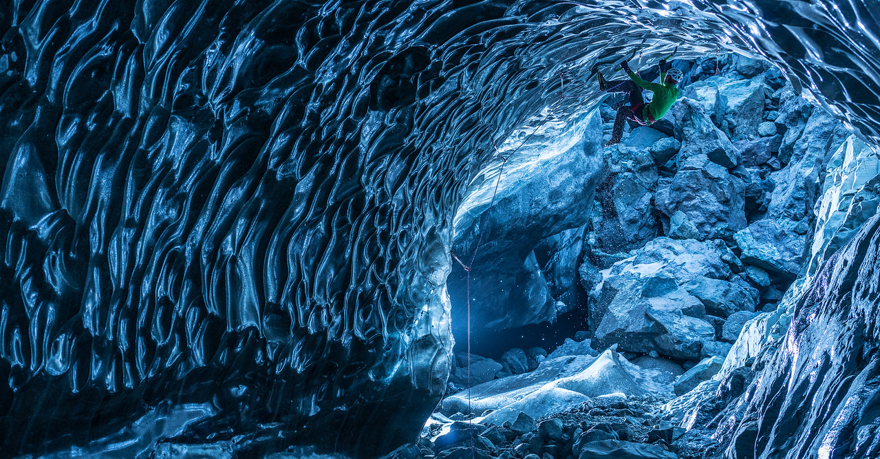 "Klemen Premrl of Slovenia climbs the ceiling of an ice cave in Iceland. Other photographs have shown climbers in ice caves ""posed,"" but Tim wanted to show real climbers actually tackling the highly difficult challenge of climbing horizontal ice.  As featured in ""Climbing Ice - The Iceland Trifecta"", presented by SmugMug Films."