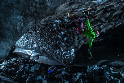 "Klemen Premrl of Slovenia climbs the ceiling of an ice cave in Iceland. Other photographs have shown climbers in ice caves ""posed,"" but Tim wanted to show real climbers actually tackling the highly difficult challenge of climbing horizontal ice.  ""There were these really beautiful textures, ripples on the sides of the walls, and I lit some of those with off-camera lighting just to bring a little bit of attention to the unique texture in the ice rather than the climbers,"" says Tim. Read more at https://www.smugmug.com/films/tim-kemple/climbing-glacier.  As featured in ""Climbing Ice - The Iceland Trifecta"", presented by SmugMug Films."