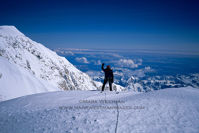 Joe Puryear celebrates atop Denali's Cassin Ridge.