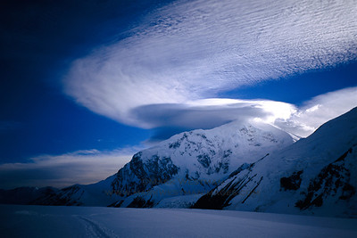Wind clouds swirl around Mount Foraker.