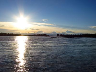 Summer sunset over the Alaska Range and the Susitna River.