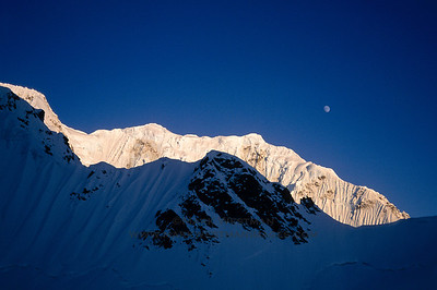 Moon over the west ridge of Mount Hunter.