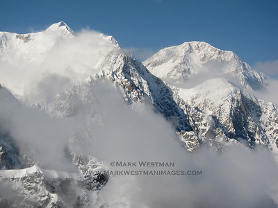 Mount Hunter's south summit (L) and Denali (R). This photo presents a good example of the effect of foreshortening: Hunter's south summit is 13,966 feet, whereas Denali is 20,320'.