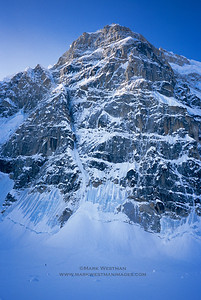 The north buttress of Mount Hunter. A climber is just barely visible approaching the wall on the lower left.