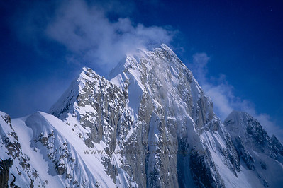 "Mount Huntington's corniced ""French"" ridge, the original line of ascent of this iconic Alaskan mountain."