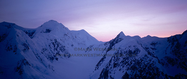Sunset over Mount Hunter and Mount Foraker from the west face of Mount Huntington.