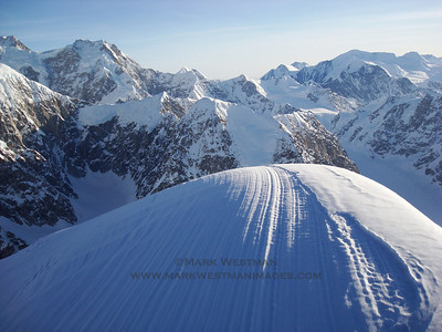 The summit cornice of Mount Huntington. The east buttress of Denali is the point to the left, Peak 11,300' is directly above the summit cornice, and Mount Silverthrone is to the right.